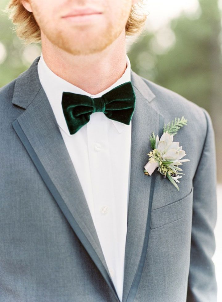 Succulent with cedar and seeded eucalyptus and a green velvet bow tie