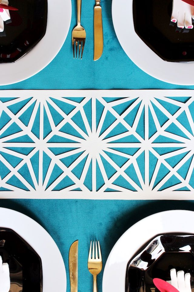 DIY Midcentury Modern Table Runner by Mandy Pellegrin for Oh So Beautiful Paper. The tutorial uses vinyl, but kraft paper, Tyvek or TerraSkin would be great too.