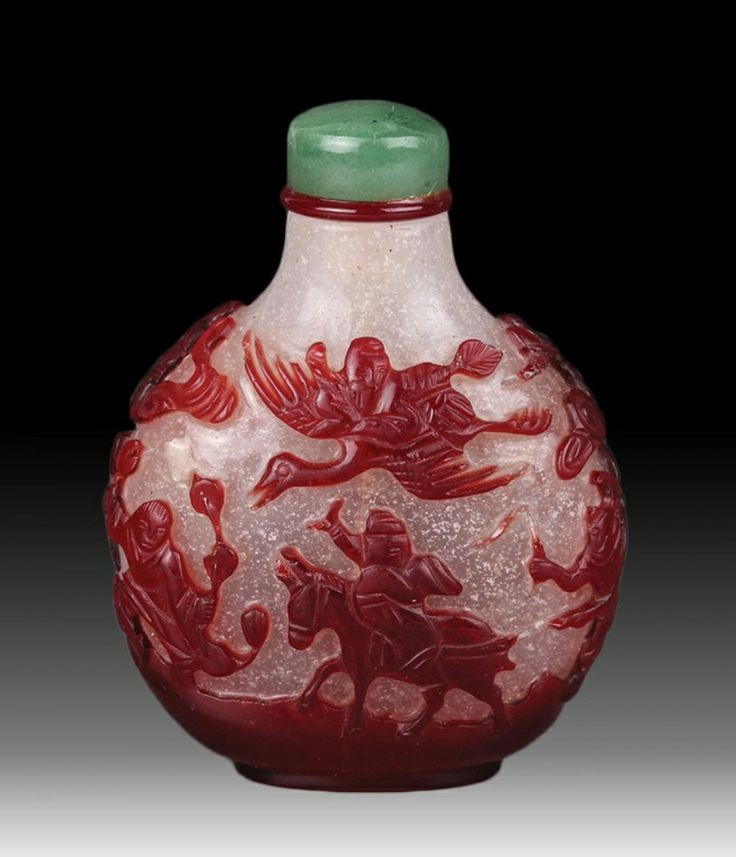 """Chinese Red overlay snow white snuff Bottle with a group of immortals traveling. 2.75""""H"""