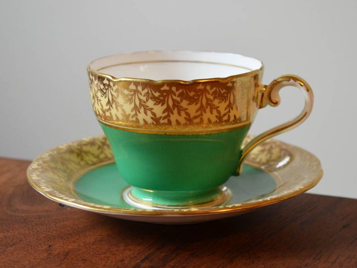 Antique Green Aynsley England Tea cup and Saucer - Bone China Kelly Green with Gold edging by Trashtiques on Etsy https://www.etsy.com/ca/listing/518138064/antique-green-aynsley-england-tea-cup