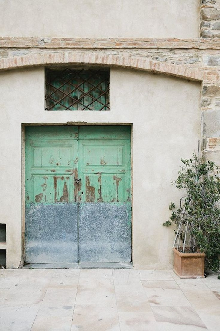 Rustic doors in Tuscany, Italy.  Pantone Lucite Green mood board on www.escapebuttonblog.com