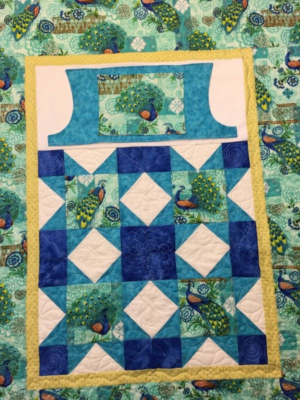 Peacock Lovie Lap Quilt with pockets to keep your hands warm from http://www.homesewnbycarolyn.com