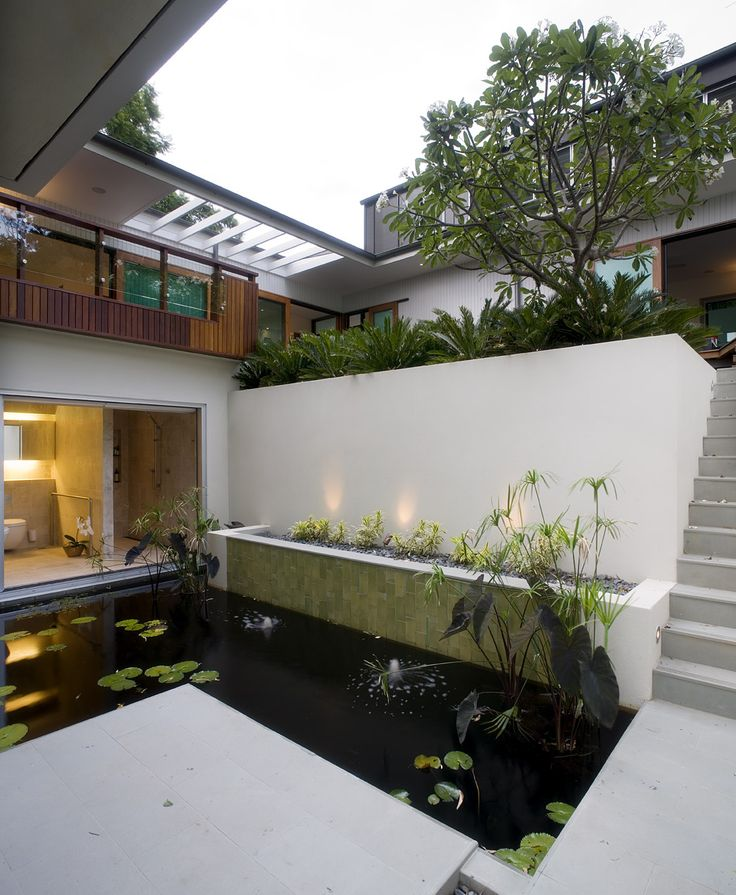 Fig Tree Pocket House 2: Pond courtyard is overlooked through floor to ceiling windows. See more at http://blighgraham.com.au/projects/fig-tree-pocket-house-2