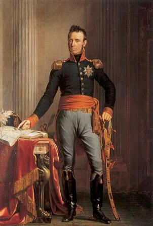 Willem Frederik van Oranje-Nassau (1772-1843), son of the last Republican Stadhouder Willem V; Sovereign from 1813, and from 1815 to 1840 King Willem I of the Netherlands. This painting by J. Paelinck was probably made shortly after the 1815 campaign; the King's finger above the map points to Waterloo. He wears the uniform of a general, with the decoration of the Order of the Garter.