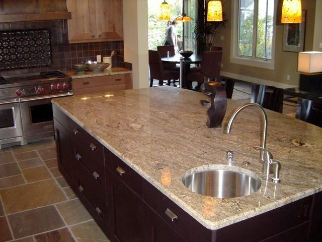 Crema Bordeaux Granite Countertops, Dark Cabinets, Slate Tiles And  Backsplash.