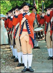 Student leading a fife and drums group