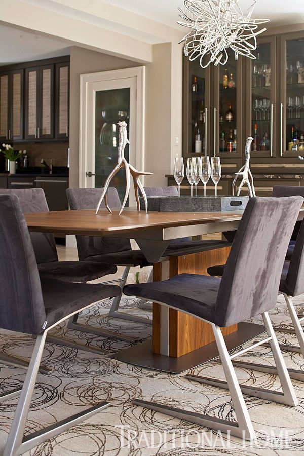 Eggplant Hued Fabric And Chrome Legs On The Dining Chairs Create A Contemporary Feel For
