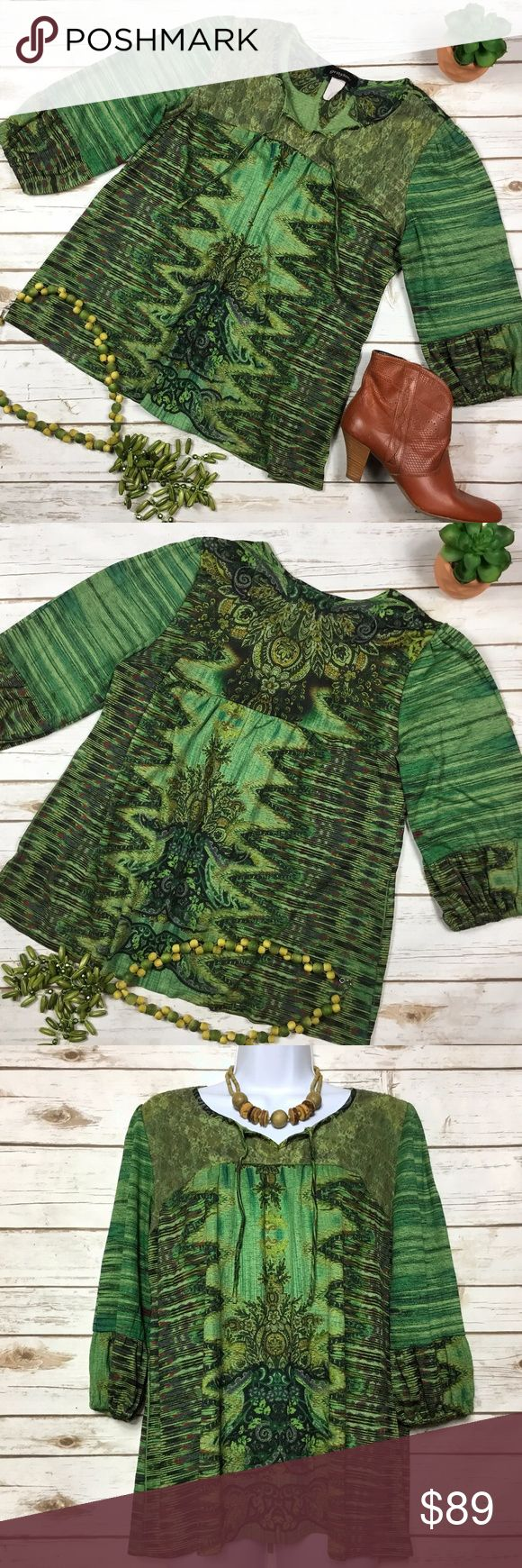 Vintage Grayson Peasant BOHO Festival Blouse Top Vintage Grayson festival peasant style boho blouse. Wonderfully patterned blouse in shades of green, orange, and copper with shimmery golden threads. Has green lace overlay and ties in front. ¾-sleeves with elastic cuffs. Judging by the materials tag, this piece is vintage. Difficult to read, but I believe it's 99% polyester and 1% spandex with nylon/polyester trim. Size L, measures about 20 inches from armpit to armpit and 24 inches in…