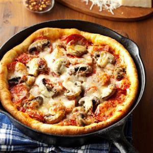 "Chicago-Style Deep-Dish Pizza Recipe -""My husband and I tried to duplicate the pizza from a popular Chicago restaurant, and I think our recipe turned out even better,"" Lynn Hamilton writes from Naperville, Illinois. ""The secret is baking it in a cast-iron skillet."""