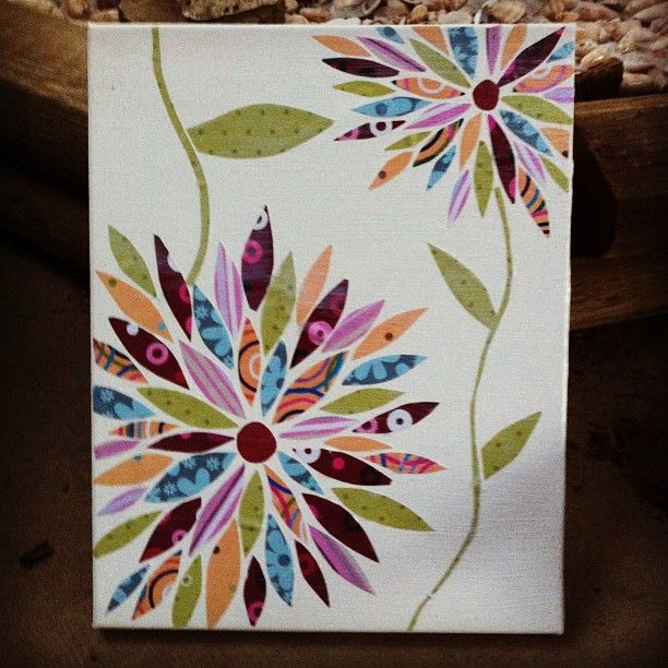 Glue Pieces pf old scrap book paper onto a blank canvas then paint mod podge over it to seal it! suppppeerrr cute for the house..hmmmmm maybe in a huskery print...what do you think @Karolyn Wertman ...one of our future craft projects?!?!