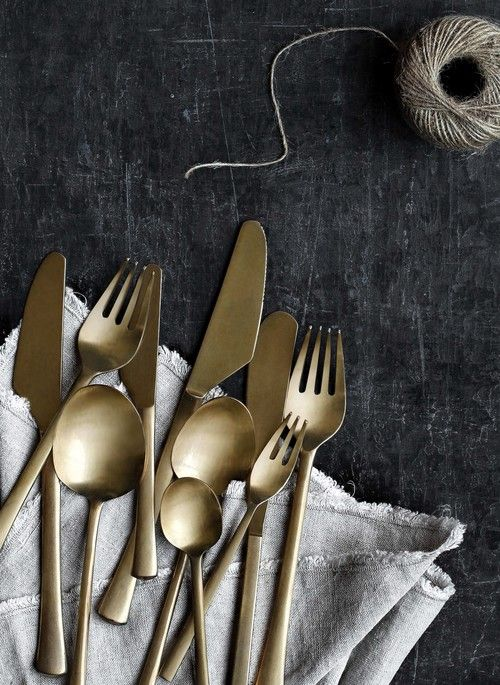 The Prop Dispensary - Hege in France black vintage table gold cutlery washed linen string