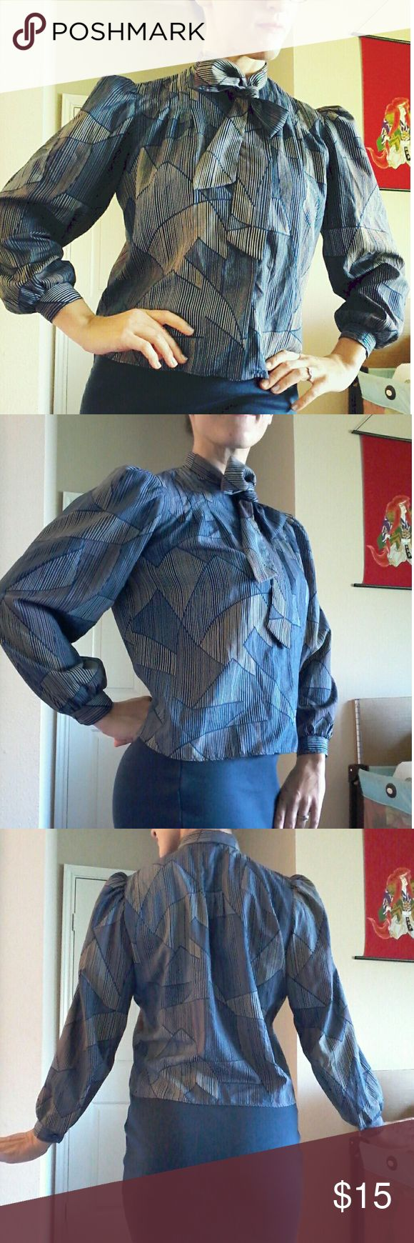 Poet Blouse This is a retro glam 60's girl dream! Puff sleeves, button up front and cuffs. Tie detail at neck. Cool blue mod design. Very lightweight! The tags are removed, so my best guesses are: cotton/poly blend, size small. I am a size 4 for reference. EUC. Tops Button Down Shirts