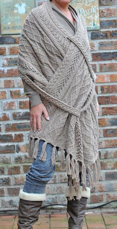 Cable and lace rectangle shawl with cable sling pull-throughs that help keep it fastened