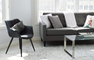 Scale down your furniture and go for the minimalist design. Ditch the heavy teakwood coffee table and opt for a glass top table with thin legs. Use furniture with exposed legs rather than those that sit on the floor, to give more visual of space.