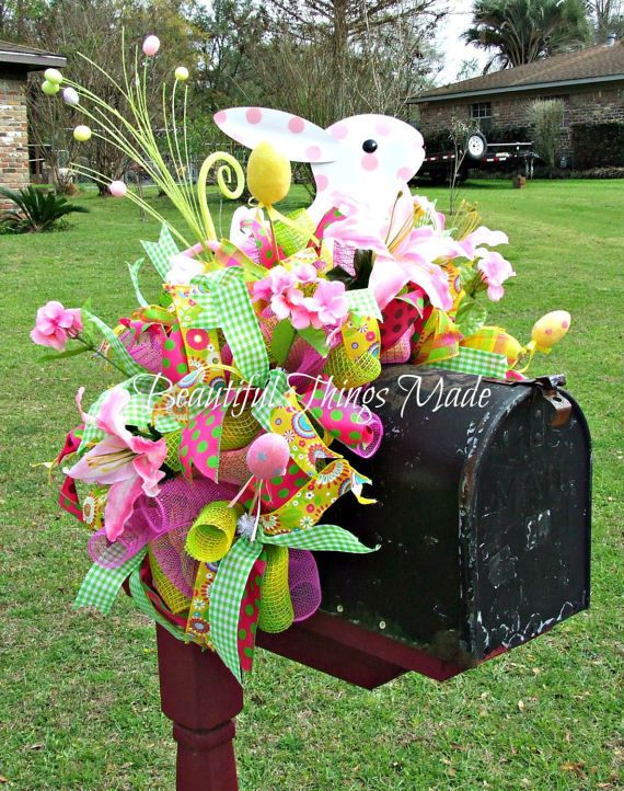 Easter mailbox topper, Mailbox swag, mailbox decoration. This is an adorable mailbox decoration. It is made with Green, Yellow and pink deco mesh, with matching deco mesh curls. It has a Cute metal bunny centered on the top, and is decorated with easter eggs, silk flowers, and wired ribbons. Dont forget to decorate your mailbox when you decorate your house. To view all of my wreaths please follow this link: https://www.etsy.com/shop/Beautifulthingsmade?section_id=16...