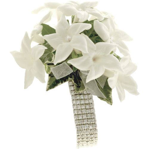 Wrist Corsage of White Stephanotis Flowers Featured on a diamante wrist band -  'Asha' is a White Stephanotis wrist corsage with options to add gorgeous wristbands. Gift box included.  Styles: Wrist corsage (pictured), shoulder corsage or hand bag corsage.  Wrist band options: Diamante wrist band (pictured), crystal bands in clear, pink, blue/purple & black & pearl wrist band in black or ivory pearls or elastic band with ribbon tie.  Seasons:  Mid November to mid to late February.