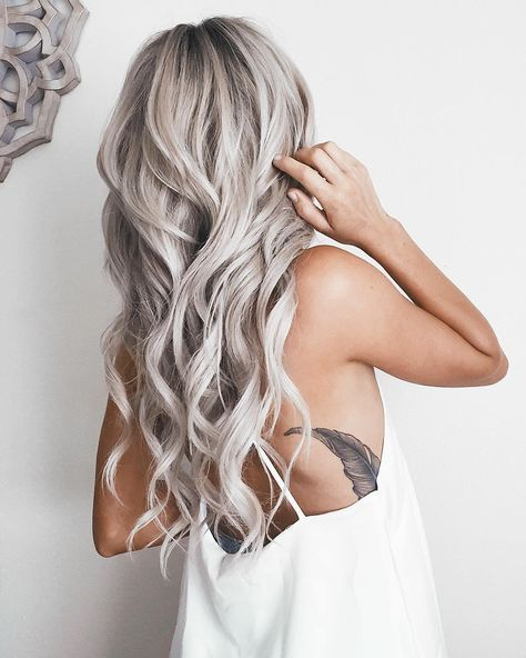 Emily Rose Shannon is slaying the hair game with her long silver locks!