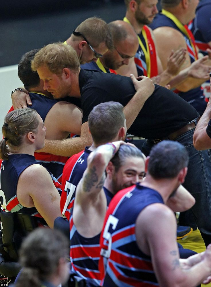 Harry is the prince of hugs! He gets physical with the members of the Team GB wheelchair basketball team at their gold medal decider