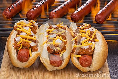 Stock Photo about Chili Hot Dogs Grilled  in Buns and on Barbecue Grill