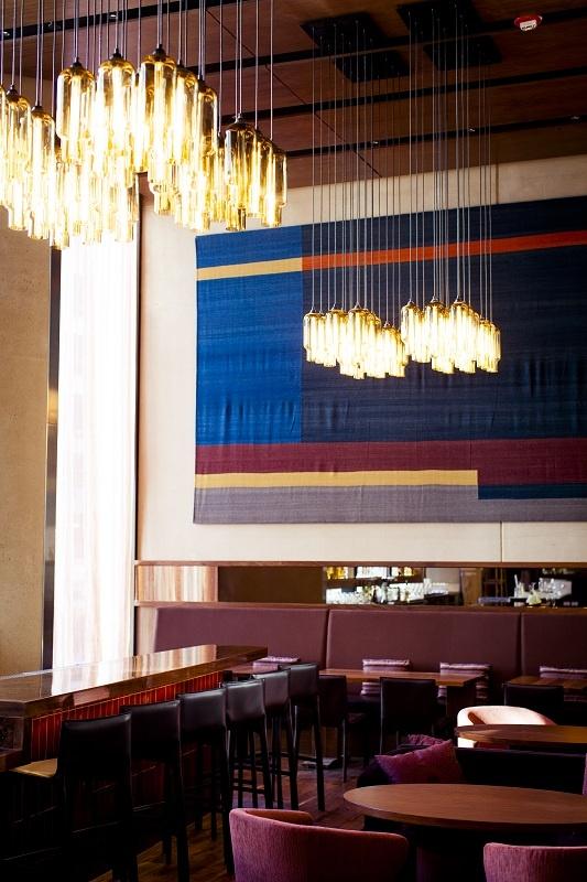 Restaurant Interior With Contemporary Decor, Pendant Lighting And Elegant  Eggplant Color