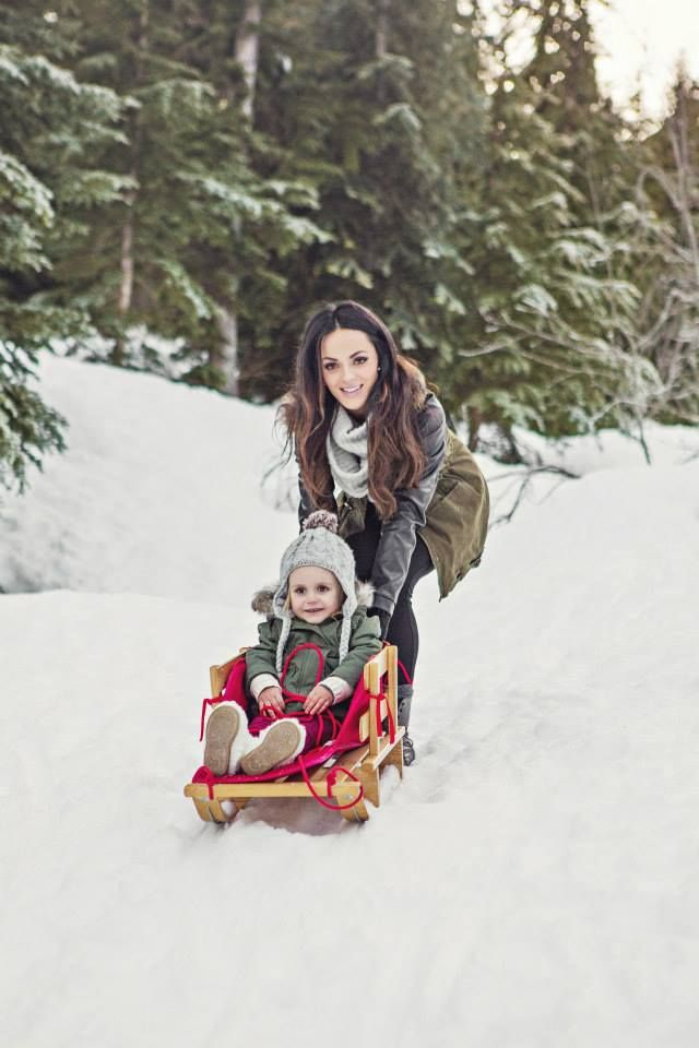 Winter family photos, mother, mommy, daughter, girl, child's place, playful, sled, snow, hat, scarf, trees, sun, Christmas, holiday.