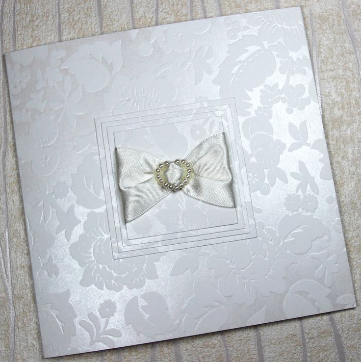 WEDDING CARDS £1.99 AND WALLET INVITATIONS £3.25 (includes an RSVP Card and pre-printed return addressed RSVP Envelope. Features the most stunning ITALIAN FLORAL CARD with an option of either a PEARL HEART or a GRADE 'A' DIAMANTE as the centerpiece that nestles between a quality ivory double satin ribbon. To increase the luxuriousness of this design we have layered the ribbon and adornment onto 4 layers of this exquisite Italian card!  For further information visit www.elegantws.co.uk