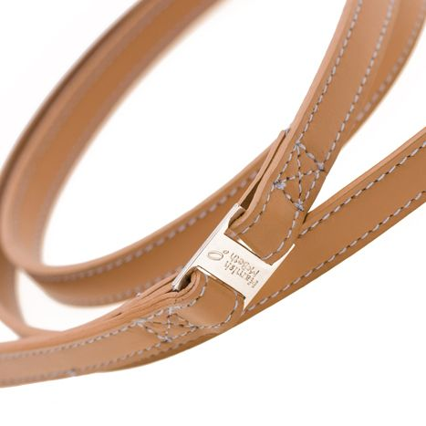 Walk the dog in classic style, and spare your hands from blisters or tears in the process. This understated, durable and genuine leather dog lead is designed to last no matter how many midnight strolls through the park you and your dog take. The tan is a vegetable tan too, using no nasty chemicals, and is manufactured to ethical standards. Pair this with the matching collar, or mix it up with another from the Savile Row collection by Hamish McBeth. #doglead #dogleash #lead #leash #leather