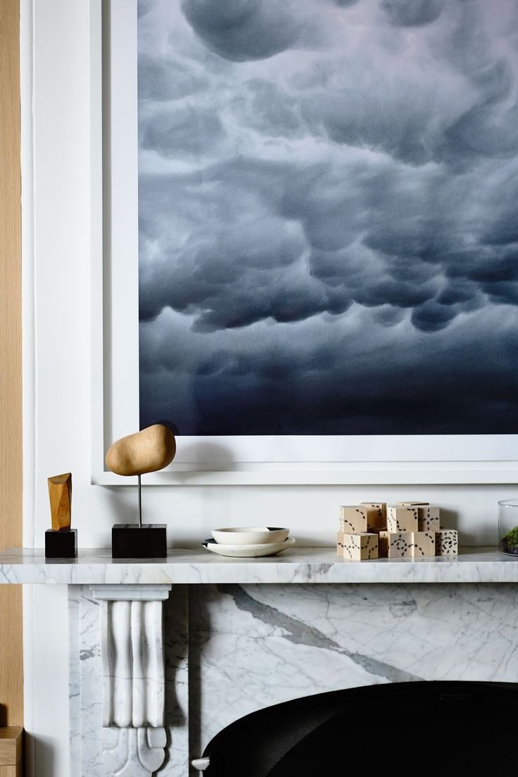 The striking artwork above the mantelpiece is by Trevor Mein.: [object Object]