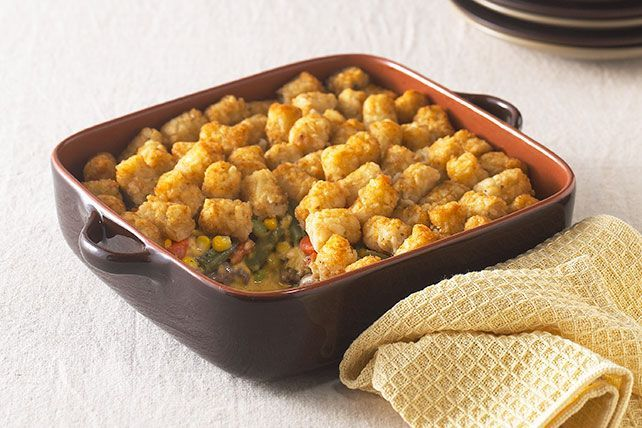 Enjoy crispy bites of potato atop this ground beef & veggie TATER TOTS Casserole recipe.  We love good ol' fashioned comfort food like TATER TOTS Casserole.