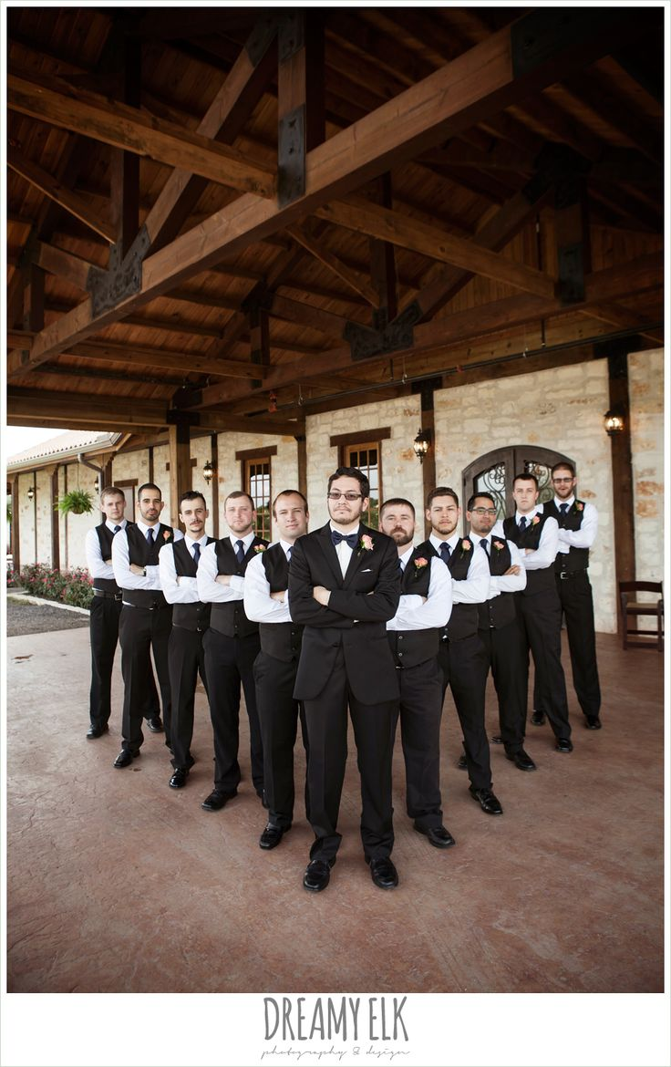 large bridal party, ten groomsmen, classic tux with navy bowtie, groomsmen in vests and bowties, outdoor bridal portrait on porch, pearl draped sleeve lace wedding dress, white wedding bouquet, pecan springs, houston, texas, photo {dreamy elk photography and design}