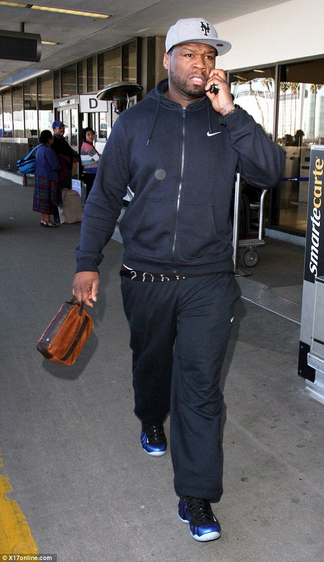 Making his way: Rapper 50 Cent was also seen making an arrival at the airport ...