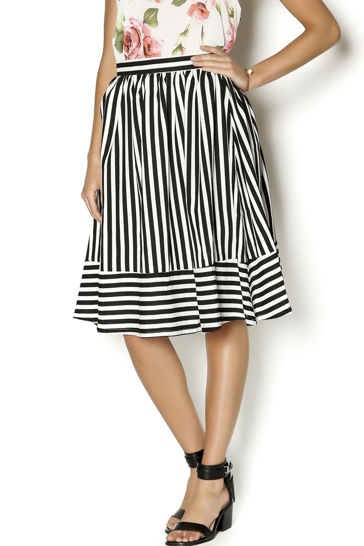 orgeous bold black and white striped midi skirt in a beautiful light weight material. Perfect with a white shirt tucked in and strappy sandals for a Parisian look!