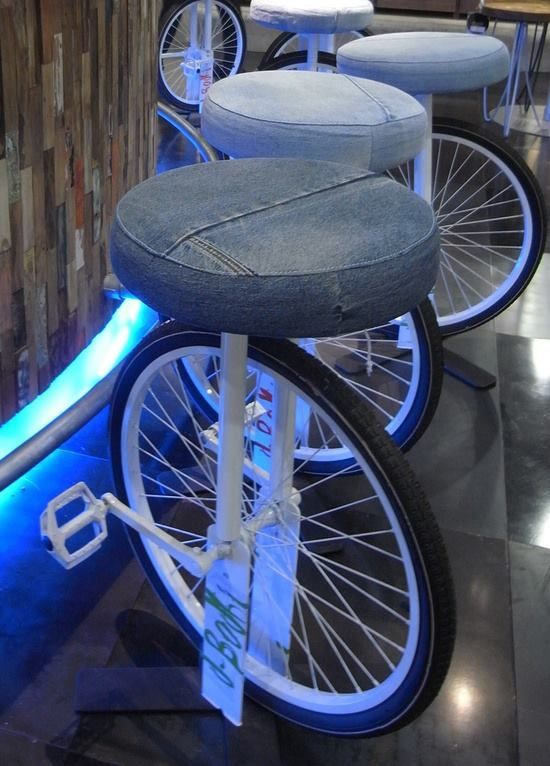 Funky bar stools made from recycled bicycle parts and reused jean material for the cushion