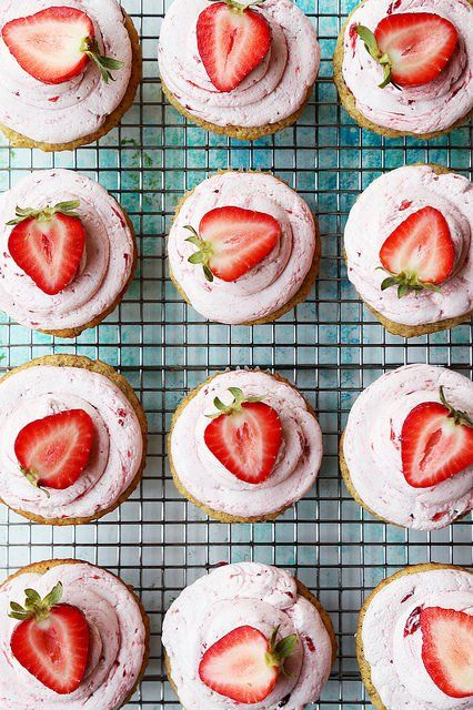 Strawberry Pistachio Cupcakes. Homemade pistachio cake topped with a light and fluffy strawberry buttercream. The perfect Mother's Day cupcake!