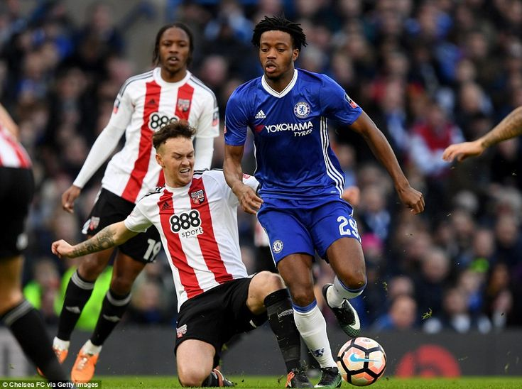 Nathaniel Chalobah of Chelsea is tackled by former Blues player Josh McEachran during the first half