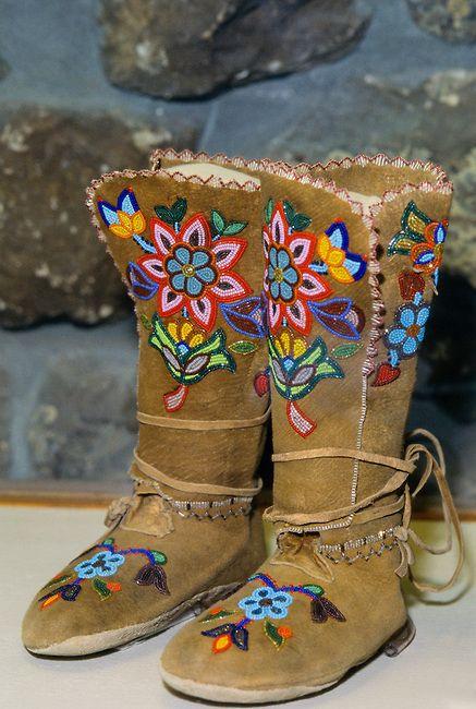 Pair of colorfully beaded Cree high-top ladies moose hide moccasins