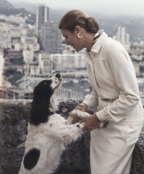 Princess Grace on the terrace of the Royal Palace in Monaco while playing with her dog, 1973.