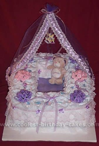 Purple and Pink Bassinet Diaper Cake... This website is the Pinterest of diaper cake ideas