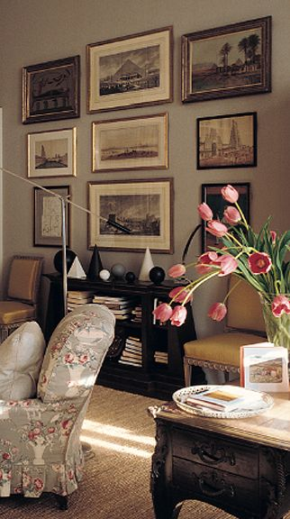 Gallery wall in a bedroom by Veere Grenney