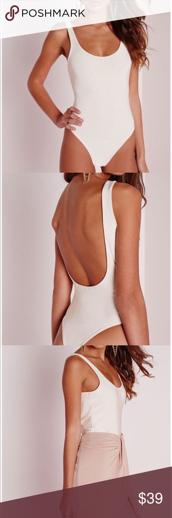 Missguided scoop back bodysuit seamless ⚡️NO trades  ⚡️open to ALL offers!  ⚡️ bundle for MAJOR discounts!  ⚡️feel free to ask any questions ⚡️ I will not respond to offers in the comments, please use the offer button for all offers.  ⚡️Please only ask for model photos if you are very interested!  ⚡️All sales are final and all offers are binding.  ⚡️ If I miss your comment, please comment again! Missguided Tops