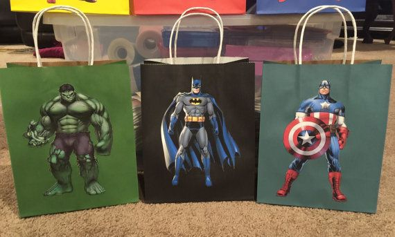 Listing is for superhero treat bags. Pictures are printed on cardstock, hand cut and placed on the bag. It can also be done on just black or white bags if you prefer instead of the color bags. I can do any number of any of the different Superheroes that you want or do a different one