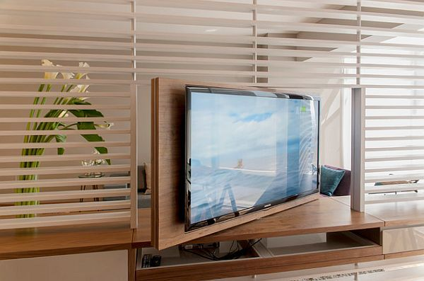 Space delimiting TV furniture in very small apartment design - Great for going from the living room to bedroom in the Berlin house. ~ Sheila