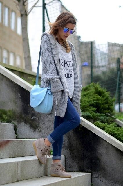 Shop this look for $153:  http://lookastic.com/women/looks/oversized-sweater-and-open-cardigan-and-crossbody-bag-and-skinny-jeans-and-wedge-sneakers/1112  — Grey Print Oversized Sweater  — Grey Open Cardigan  — Light Blue Leather Crossbody Bag  — Blue Skinny Jeans  — Tan Wedge Sneakers