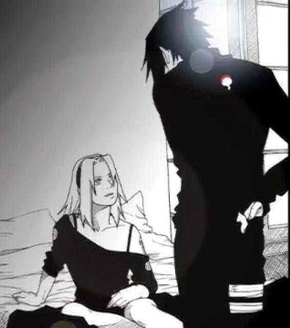 Sasuke and Sakura and it looks like Sakura is getting scolded at...
