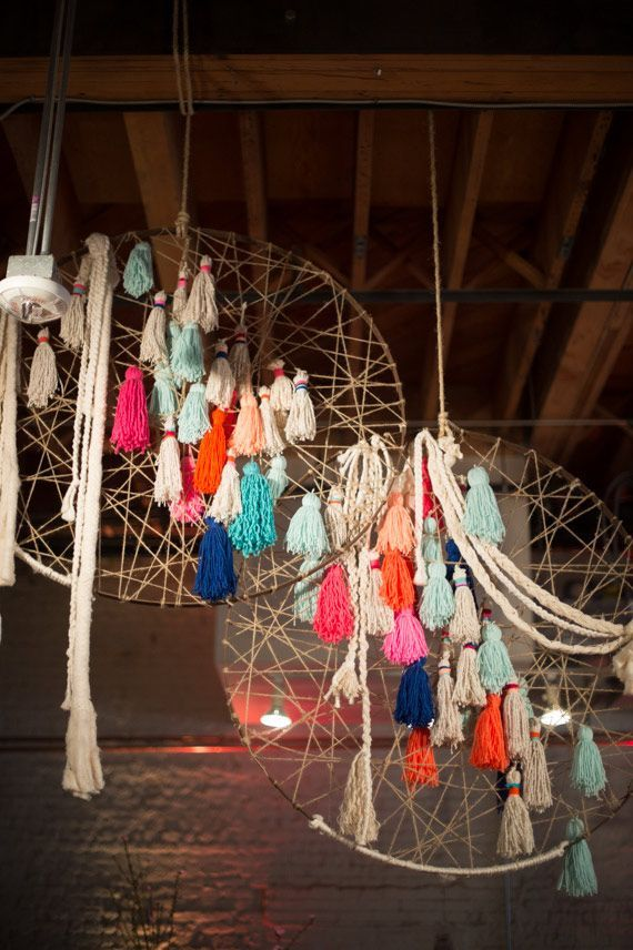 tassel dreamcatcher--- this could be anywhere: behind the bar, dessert table, or dance floor. I LOVE these dyed yarn tassels on a simple dreamcatcher.This would be so easy to do!: