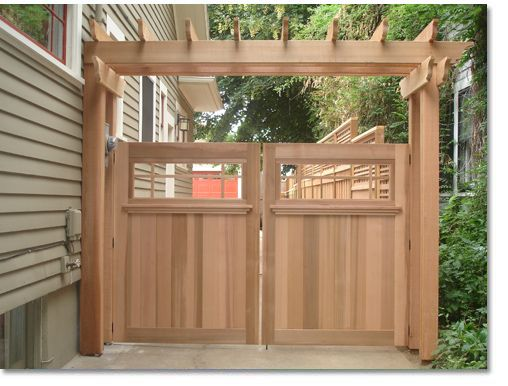 Love the wooden gate with the pergola above it