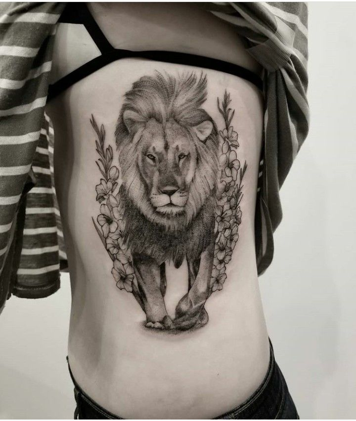 My First Tattoo Male Lion Walking Through Gladiolus Lion Tattoo Small Lion Tattoo For Women Tattoos