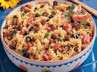 Taco Pasta Salad Recipe - this sounds like my mom's taco salad recipe (but with pasta of course).  May need to give this a whirl