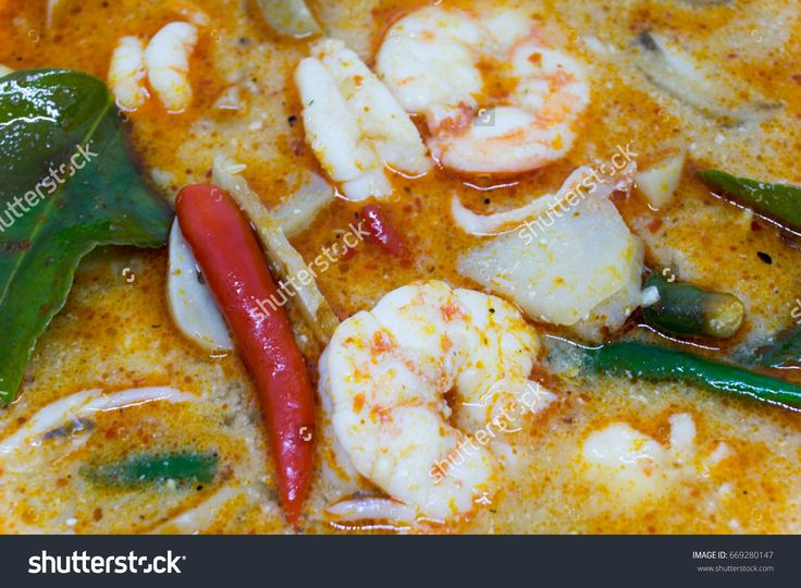 close up Home Made River prawn spicy soup or Tom Yum Kung. thai spicy food.
