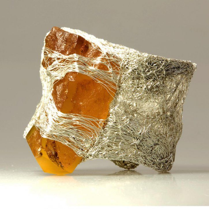 Raw amber and silver cuff by Pawel Kaczynski.